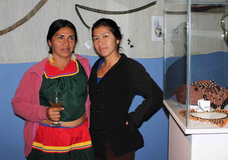 Cofán Artisans Feliza Ortiz and daughter Marhy Mendua at La Cuchara de San Marcos Exhibit in Quito, Ecuador.