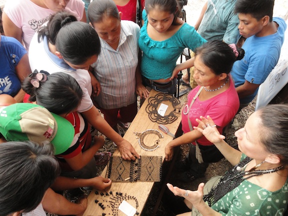 Designer Violeta Villacorta showing Yanesha Artisans samples of Cofán and Awajún Jewelry